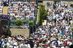 FILE - In this July 4, 2019, file photo, spectators fill seats and passageways during day four of the Wimbledon Tennis Championships in London. Major League Baseball is trying to muscle in on a crowded marketplace in Britain dominated by soccer but also filled with cricket, rugby _ and this month Wimbledon. (AP Photo/Ben Curtis, File)