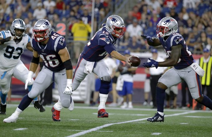 New England Patriots quarterback Tom Brady (12) hands off to running back Sony Michel (26) as fullback James Develin (46) blocks in the first quarter an NFL preseason football game against the Carolina Panthers, Thursday, Aug. 22, 2019, in Foxborough, Mass. (AP Photo/Elise Amendola)