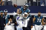 Dallas Cowboys cornerback Maurice Canady, left, defends as Philadelphia Eagles wide receiver Quez Watkins (16) reaches out to make a catch in the second half of an NFL football game in Arlington, Texas, Monday, Sept. 27, 2021. (AP Photo/Ron Jenkins)