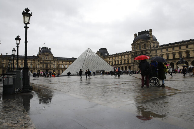 The Louvre museum is pictured in Paris, Monday, March 2, 2020. The Louvre Museum was closed again Monday as management was meeting with staff worried about the spread of the new virus in the world's most-visited museum. (AP Photo/Christophe Ena)
