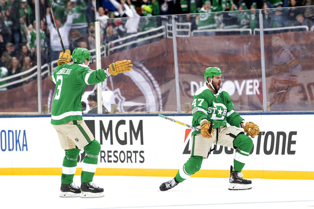 Dallas Stars right wing Alexander Radulov (47) celebrates his goal with defenseman John Klingberg (3) in the third period of the NHL Winter Classic hockey game against the Nashville Predators at the Cotton Bowl, Wednesday, Jan. 1, 2020, in Dallas. Dallas won 4-2. (AP Photo/Jeffrey McWhorter)