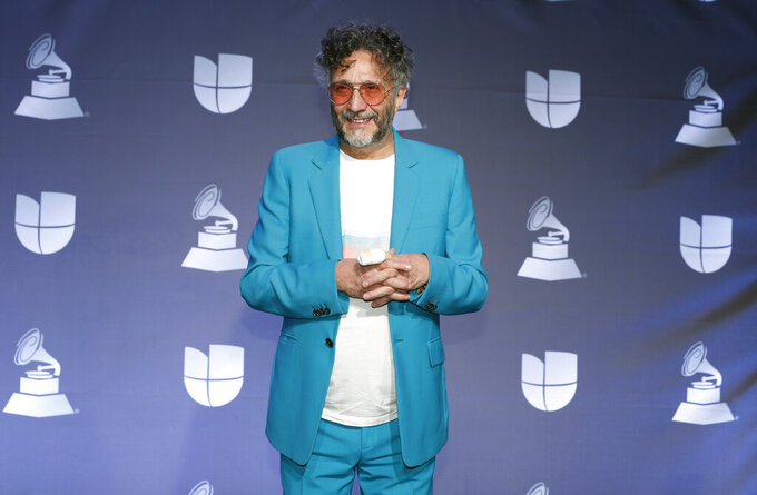 """FILE - Argentine rockstar Fito Paez poses in the press room at the 20th Latin Grammy Awards in Las Vegas on Nov. 14, 2019. Paez is nominated for a Grammy for Best Latin Rock or Alternative Album for """"La Conquista del Espacio."""" (Photo by Eric Jamison/Invision/AP, File)"""