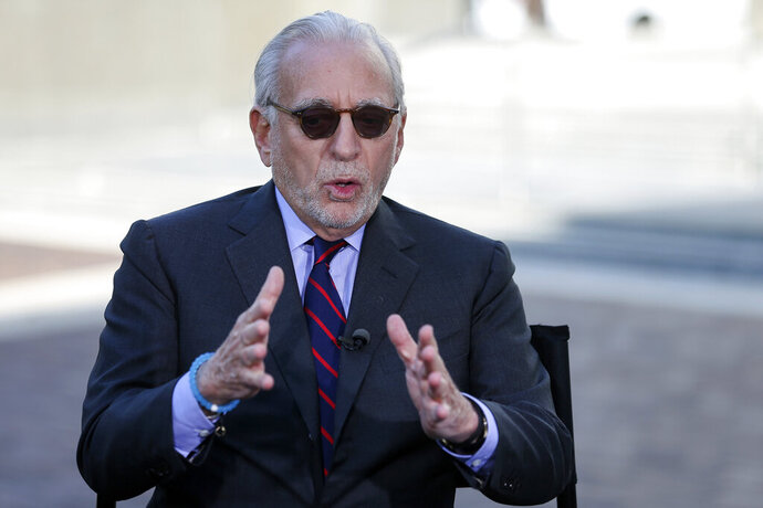 FILE- In this Oct. 10, 2017, file photo Trian Partners hedge fund manager Nelson Peltz is interviewed by CNBC's Sara Eisen after Procter & Gamble's annual shareholders meeting in Cincinnati. Shares in Aurora Cannabis jumped on Wednesday, March 13, 2019, after the Canadian company announced that it has appointed Peltz as a senior adviser. (Kareem Elgazzar/The Cincinnati Enquirer via AP, File)