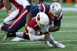 New England Patriots defensive lineman Adam Butler, top, sacks Arizona Cardinals quarterback Kyler Murray in the second half of an NFL football game, Sunday, Nov. 29, 2020, in Foxborough, Mass. (AP Photo/Elise Amendola)