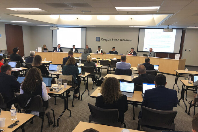 In this Oct. 30, 2019, photo, the Oregon Investment Council conducts its monthly meeting in Tigard, Ore. In 2017, the council decided unanimously to invest $233 million of the state workers' pension fund in Novalpina Capital, a private equity fund, which later bought into Israeli spyware company NSO Group. Major international human rights groups said NSO Group's Pegasus spyware has been used by repressive governments against human rights defenders, dissidents and journalists. (AP Photo/Andrew Selsky)