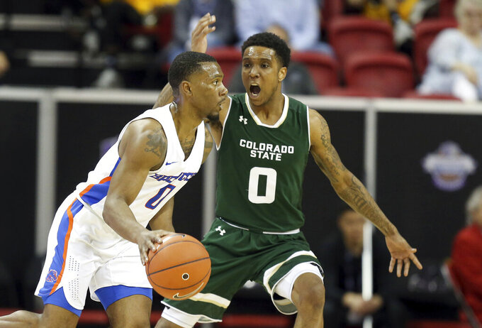 Colorado State's Hyron Edwards (0) defends as Boise State's Marcus Dickinson drives during the second half of an NCAA college basketball game in the Mountain West Conference tournament Wednesday, March 13, 2019, in Las Vegas. (AP Photo/Isaac Brekken)