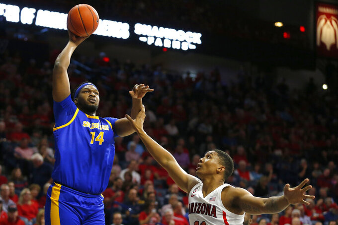 San Jose State center Samuel Japhet-Mathias (14) shoots over Arizona forward Ira Lee during the first half of an NCAA college basketball game Thursday, Nov. 14, 2019, in Tucson, Ariz. (AP Photo/Rick Scuteri)