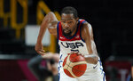 United States' Kevin Durant (7) chases the ball during men's basketball gold medal game against France at the 2020 Summer Olympics, Saturday, Aug. 7, 2021, in Saitama, Japan. (AP Photo/Charlie Neibergall)