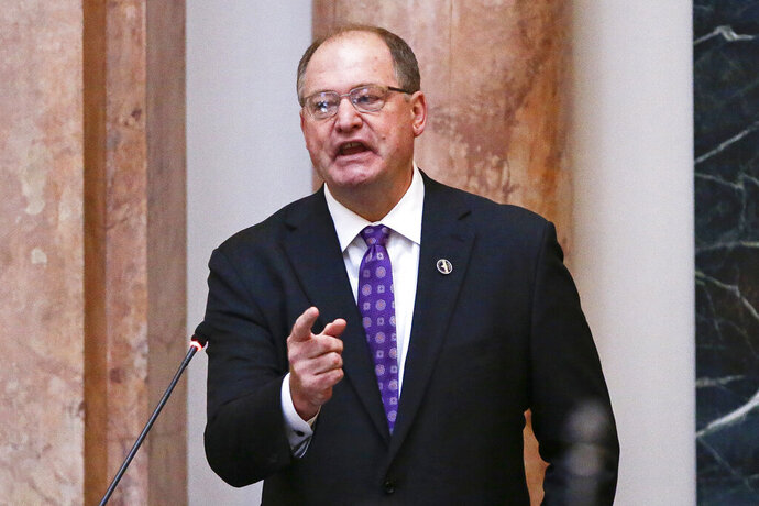 FILE – In this Jan. 8, 2018, file photo, Kentucky House Speaker Jeff Hoover resigns from his leadership position during a speech at the State Capitol in Frankfort, Ky. Hoover has dropped a lawsuit demanding that a woman give back the $110,000 she received in a secret sexual harassment settlement involving them. An attorney for Hoover and two other men announced Friday, Aug. 9, 2019 that his clients agreed to dismiss their lawsuit against the woman, a former Republican staffer.   (AP Photo/Michael Reaves, File)
