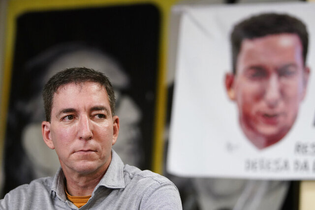 """FILE - In this July 30, 2019 file photo, award-winning journalist Glenn Greenwald listens to a question during a press conference before the start of a protest in his support in front of the headquarters of the Brazilian Press Association, known as ABI, in the city of Rio de Janeiro, Brazil. Greenwald is working on a book about his reporting on corruption in Brazilian politics that led to threats of retaliation from the government of President Jair Bolsonaro. The book is tentatively titled """"You Can't Silence This"""" and is scheduled for 2021, Henry Holt and Company announced Tuesday, March 30, 2020. (AP Photo/Ricardo Borges, File)"""