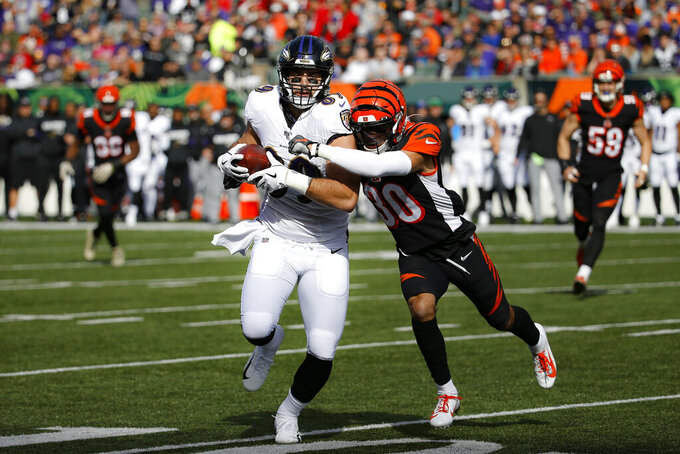 Baltimore Ravens tight end Mark Andrews, left, runs the ball against Cincinnati Bengals free safety Jessie Bates (30) during the first half of NFL football game, Sunday, Nov. 10, 2019, in Cincinnati. (AP Photo/Frank Victores)