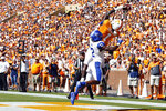 Tennessee wide receiver Marquez Callaway (1) catches a touchdown pass as he is defended by Georgia State cornerback Tyler Gore (12) in the first half of an NCAA college football game Saturday, Aug. 31, 2019, in Knoxville, Tenn. (AP Photo/Wade Payne)