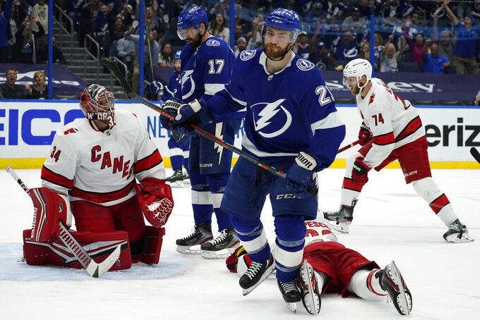 Tampa Bay Lightning center Brayden Point (21) reacts after scoring past Carolina Hurricanes goaltender Petr Mrazek (34) during the second period in Game 3 of an NHL hockey Stanley Cup second-round playoff series Thursday, June 3, 2021, in Tampa, Fla. (AP Photo/Chris O'Meara)