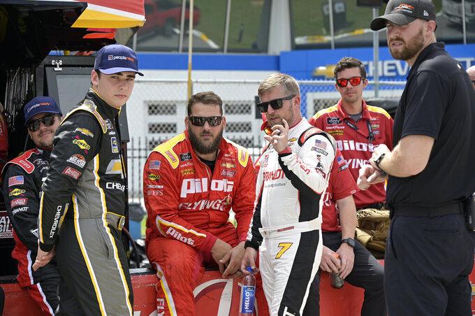 Drivers Sam Mayer, second from left, and Justin Allgaier (7) chat on pit road before a NASCAR Xfinity Series auto race at Daytona International Speedway, Saturday, Aug. 28, 2021, in Daytona Beach, Fla. (AP Photo/Phelan M. Ebenhack)