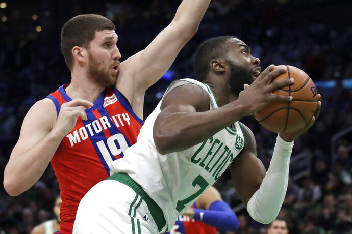 Boston Celtics guard Jaylen Brown (7) beats Detroit Pistons guard Sviatoslav Mykhailiuk (19) to the hoop in the first quarter of an NBA basketball game, Friday, Dec. 20, 2019, in Boston. (AP Photo/Elise Amendola)