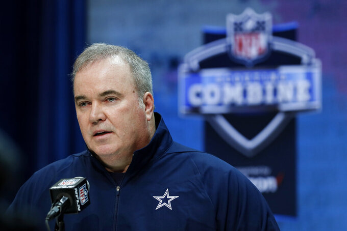 FILE - In this Feb. 26, 2020, file photo, Dallas Cowboys head coach Mike McCarthy speaks during a press conference at the NFL football scouting combine in Indianapolis. The Cowboys are headed in a new direction philosophically on defense under first-year coach Mike McCarthy. (AP Photo/Charlie Neibergall, File)