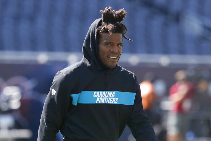 FILE - In this Aug. 8, 2019, file photo, Carolina Panthers' Cam Newton walks across the field before an NFL preseason football game against the Chicago Bears in Chicago. The Los Angeles Rams play at the Carolina Panthers on Sunday. (AP Photo/Charles Rex Arbogast, File)