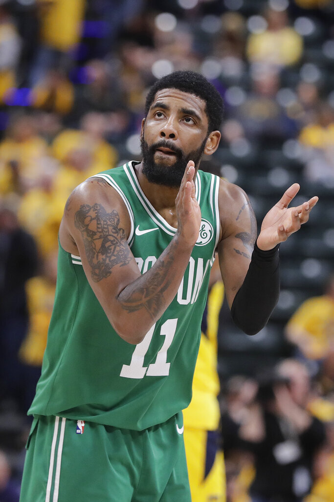 Boston Celtics' Kyrie Irving reacts during the second half of Game 3 of the team's NBA basketball first-round playoff series against the Indiana Pacers, Friday, April 19, 2019, in Indianapolis. Boston won 104-96. (AP Photo/Darron Cummings)