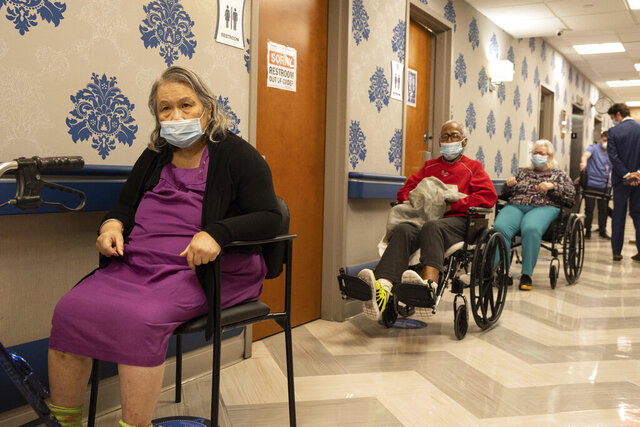 Nursing home residents make a line for the coronavirus disease (COVID-19) vaccine at Harlem Center for Nursing and Rehabilitation, a nursing home facility, on Friday, Jan. 15, 2021 in Harlem neighborhood of New York. (AP Photo/Yuki Iwamura)
