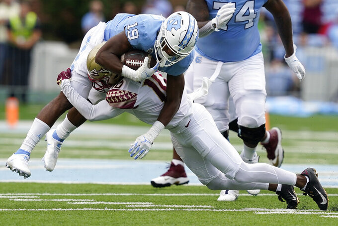 Florida State defensive back Jammie Robinson (10) tackles North Carolina running back Ty Chandler (19) during the first half of an NCAA college football game in Chapel Hill, N.C., Saturday, Oct. 9, 2021. (AP Photo/Gerry Broome)