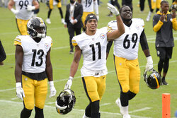 Pittsburgh Steelers' Chase Claypool (11), James Washington (13) and Kevin Dotson (69) leave the field after an NFL football game against the Tennessee Titans Sunday, Oct. 25, 2020, in Nashville, Tenn. The Steelers won 27-24. (AP Photo/Mark Zaleski)