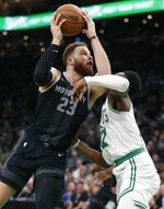 Detroit Pistons' Blake Griffin (23) shoots against Boston Celtics' Jaylen Brown (7) during the second half of an NBA basketball game in Boston, Wednesday, Feb. 13, 2019. (AP Photo/Michael Dwyer)
