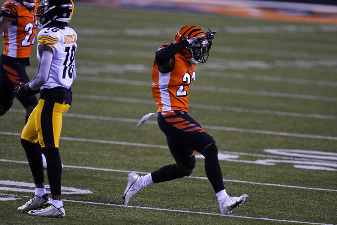 Cincinnati Bengals' Mackensie Alexander (21) reacts to breaking up a pass during the first half of an NFL football game against the Pittsburgh Steelers, Monday, Dec. 21, 2020, in Cincinnati. (AP Photo/Michael Conroy)