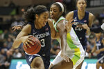 Connecticut's Megan Walker, left, drives past South Florida's Shae Leverett during the second half of an NCAA college basketball game Sunday, Feb. 16, 2020, in Tampa, Fla. (AP Photo/Mike Carlson)