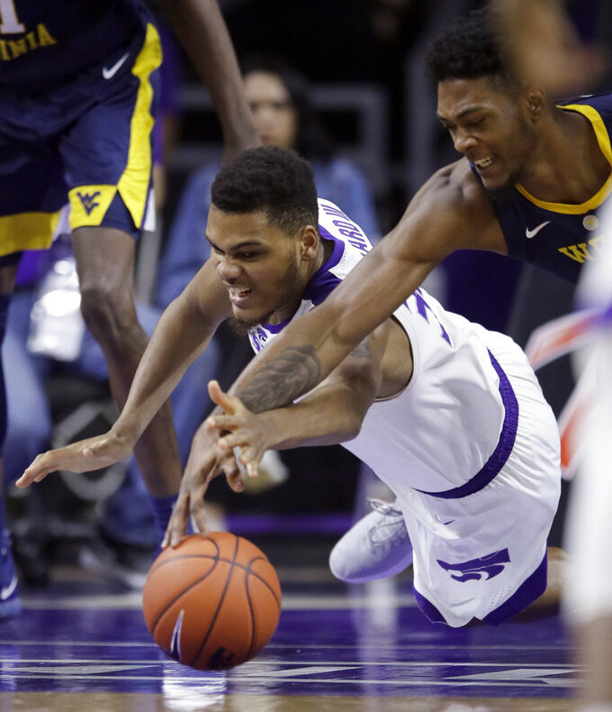 Kansas State forward Levi Stockard III (34) dives for the ball against West Virginia forward Derek Culver, right, during the first half of an NCAA college basketball game in Manhattan, Kan., Wednesday, Jan. 9, 2019. (AP Photo/Orlin Wagner)