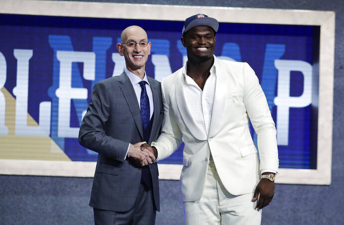 FILE - In this June 20, 2019, file photo, Duke's Zion Williamson, right, poses with NBA Commissioner Adam Silver after being selected by the New Orleans Pelicans as the first pick during the NBA basketball draft, in New York. Picked No. 1 in the NBA draft. Signed his first pro contract that could be worth as much as $45 million over the next four years. Went to summer league and got hurt after nine minutes. Landed a massive endorsement deal with Jordan Brand. And now, a video game deal. Williamson has signed with 2K, he and the video-game giant announced Tuesday, July 30, 2019, and the former Duke standout will make his video-game debut in NBA 2K20 when it launches on Sept. 6.(AP Photo/Julio Cortez, File)
