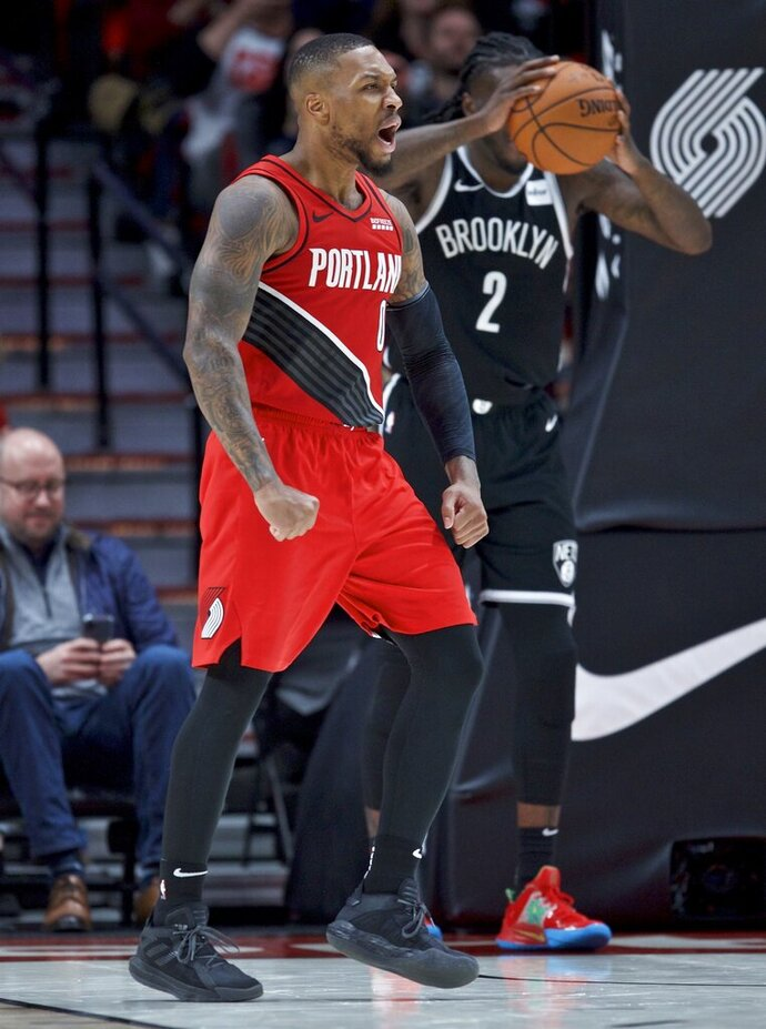 Portland Trail Blazers guard Damian Lillard reacts after scoring his 50th point of the night, during the second half of the team's NBA basketball game against the Brooklyn Nets in Portland, Ore., Friday, Nov. 8, 2019. (AP Photo/Craig Mitchelldyer)