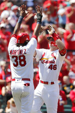 St. Louis Cardinals' Paul Goldschmidt (46) is congratulated by teammate Jose Martinez (38) after hitting a three-run home run during the seventh inning of a baseball game against the Pittsburgh Pirates Wednesday, July 17, 2019, in St. Louis. (AP Photo/Jeff Roberson)