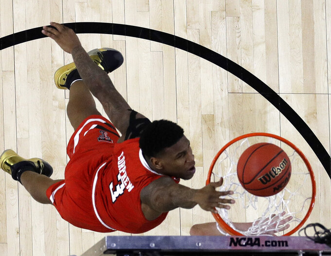 Texas Tech's Deshawn Corprew (3) goes up for a basket during the first half in the semifinals of the Final Four NCAA college basketball tournament against Michigan State, Saturday, April 6, 2019, in Minneapolis. (AP Photo/David J. Phillip)