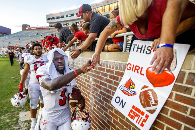 Louisville quarterback Malik Cunningham celebrates with fans after defeating Florida State 31-23 in an NCAA college football game in Tallahassee, Fla., Saturday, Sept. 25, 2021. (AP Photo/Mark Wallheiser)