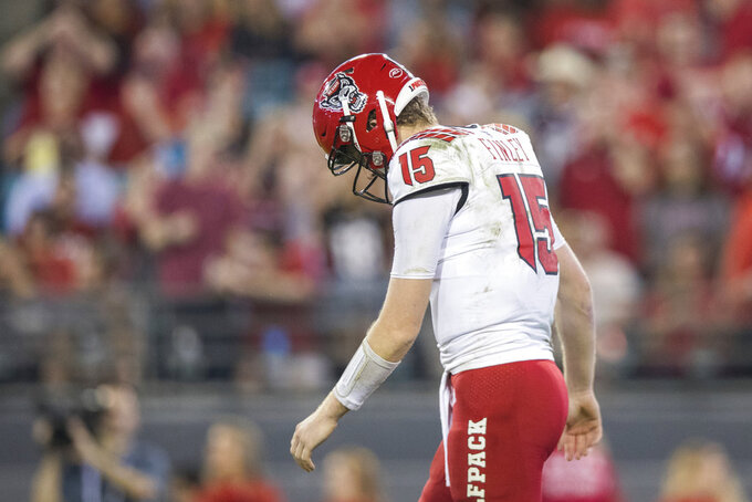 North Carolina State quarterback Ryan Finley (15) reacts after throwing an incomplete pass on third down down during the first half against Texas A&M in the Gator Bowl NCAA college football game Monday, Dec. 31, 2018, in Jacksonville, Fla. (James Gilbert/The Florida Times-Union via AP)