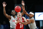New Mexico guard JaQuan Lyle, left, watches as New Mexico guard Zane Martin (0) tries to prevent a pass by Wisconsin guard Trevor Anderson (12) in the second half of an NCAA college basketball game in the Legends Classic, Tuesday, Nov. 26, 2019, in New York. New Mexico defeated Wisconsin 59-50. (AP Photo/Kathy Willens)