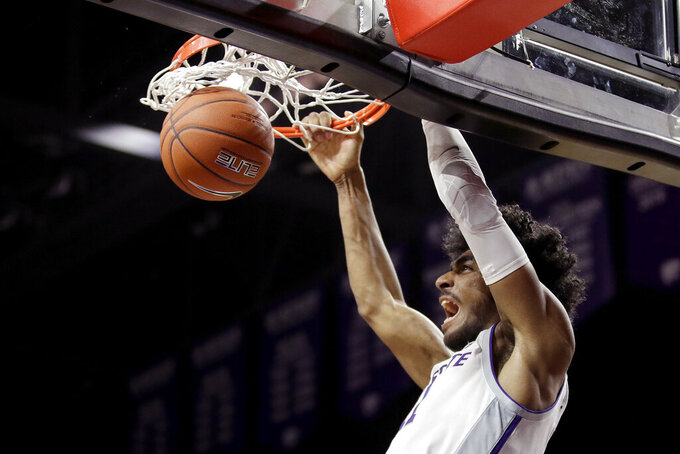 Kansas State's Antonio Gordon dunks during the first half of an NCAA college basketball game against Florida A&M, Monday, Dec. 2, 2019, in Manhattan, Kan. (AP Photo/Charlie Riedel)