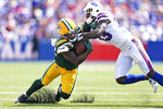 Green Bay Packers running back Kylin Hill, left, tries to break free of Buffalo Bills defensive back Siran Neal (33) during the first half of a preseason NFL football game, Saturday, Aug. 28, 2021, in Orchard Park, N.Y. (AP Photo/Joshua Bessex)
