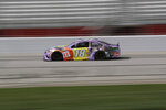 Kyle Busch (18) drives during a NASCAR Cup Series auto race at Atlanta Motor Speedway, Sunday, June 7, 2020, in Hampton, Ga. (AP Photo/Brynn Anderson)