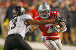 Colorado safety Derrion Rakestraw (3) tackles Utah running back Zack Moss (2) in the second half during an NCAA college football game Saturday, Nov. 30, 2019, in Salt Lake City. (AP Photo/Rick Bowmer)