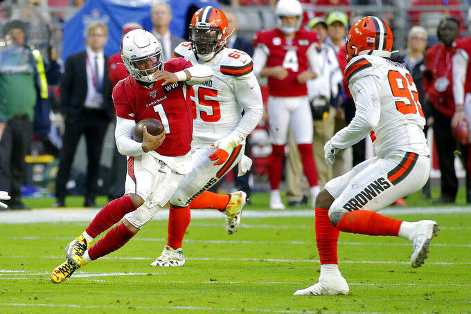 Arizona Cardinals quarterback Kyler Murray (1) scrambles as Cleveland Browns defensive end Chad Thomas defends during the first half of an NFL football game, Sunday, Dec. 15, 2019, in Glendale, Ariz. (AP Photo/Rick Scuteri)