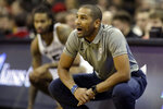 Butler head coach LaVall Jordan talks to his players during the first half of an NCAA college basketball game against Missouri, Monday, Nov. 25, 2019, in Kansas City, Mo. (AP Photo/Charlie Riedel)