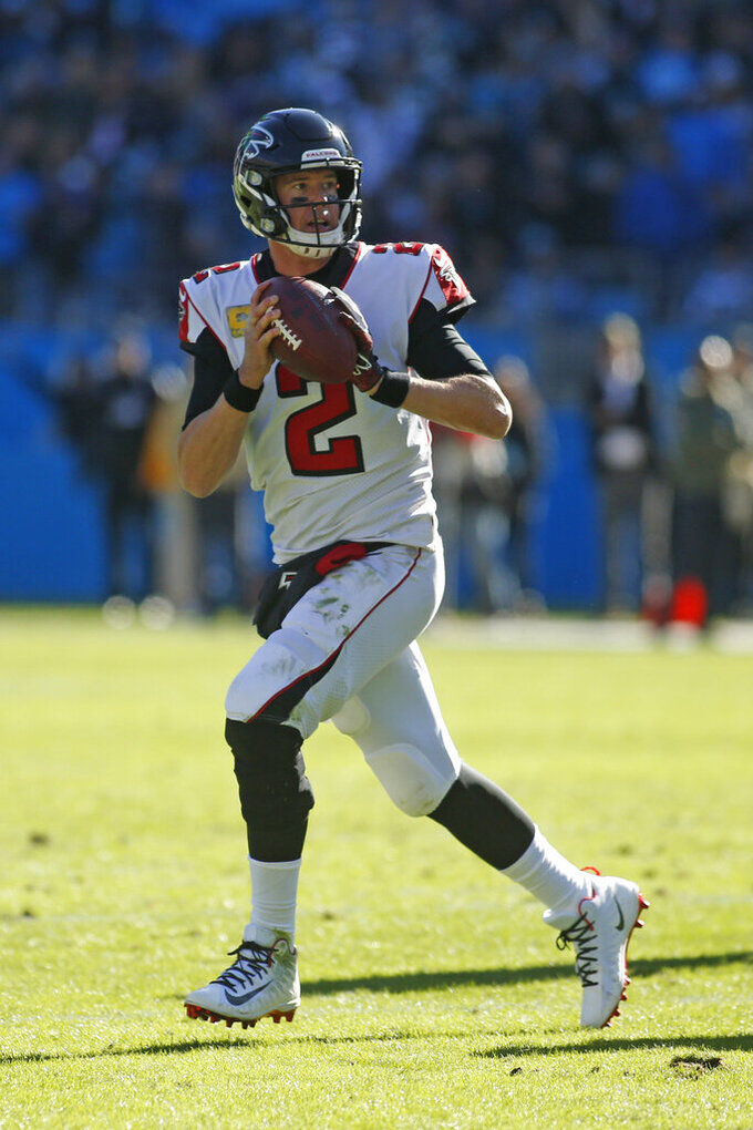 Atlanta Falcons quarterback Matt Ryan (2) looks to pass against the Carolina Panthers during the first half of an NFL football game in Charlotte, N.C., Sunday, Nov. 17, 2019. (AP Photo/Brian Blanco)
