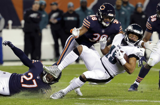 Chicago Bears defensive back Sherrick McManis (27) tackles Philadelphia Eagles wide receiver Golden Tate (19) during the first half of an NFL wild-card playoff football game Sunday, Jan. 6, 2019, in Chicago. (AP Photo/Nam Y. Huh)