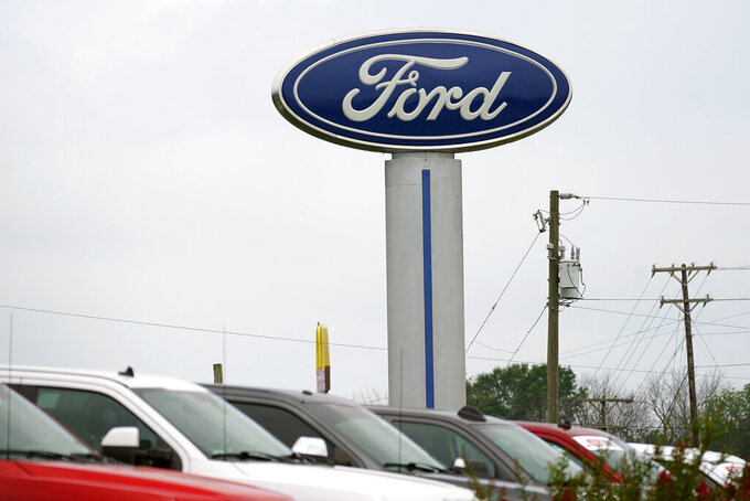 A Ford logo is seen on signage at Country Ford in Graham, N.C., Tuesday, July 27, 2021. Ford Motor Co. is investing $50 million in an upstart electric vehicle battery recycling company as the automaker moves to bolster its U.S. battery supply chain. (AP Photo/Gerry Broome)