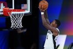 San Antonio Spurs' Lonnie Walker IV dunks against the Memphis Grizzlies during the second half of an NBA basketball game Sunday, Aug. 2, 2020, in Lake Buena Vista, Fla. (AP Photo/Ashley Landis, Pool)