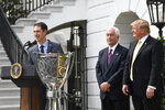Joey Logano, left, the 2018 NASCAR Cup Series Champion, speaks during an event on the South Lawn of the White House in Washington, Tuesday, April 30, 2019, with President Donald Trump, right, and Penske team owner Roger Penske, center. (AP Photo/Susan Walsh)