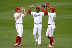 Washington Nationals outfielders Victor Robles, center, Andrew Stevenson, left, and Juan Soto, right, celebrate after the first baseball game of a doubleheader against the New York Mets, Saturday, Sept. 26, 2020, in Washington. The game was a makeup from Sept. 25. (AP Photo/Nick Wass)