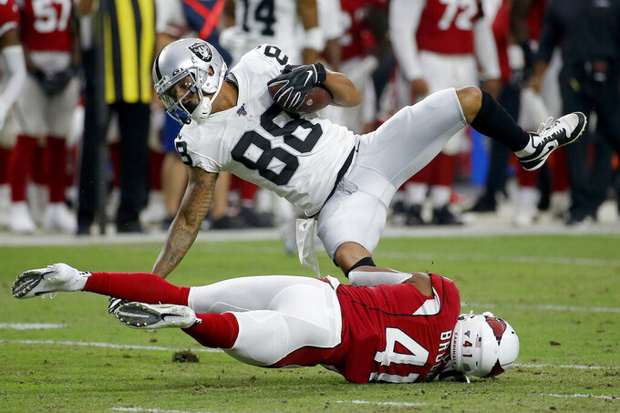 Oakland Raiders wide receiver Marcell Ateman (88) is hit by Arizona Cardinals defensive back Nate Brooks (41) during the first half of an an NFL football game, Thursday, Aug. 15, 2019, in Glendale, Ariz. (AP Photo/Rick Scuteri)