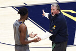 West Virginia coach Bob Huggins speaks with forward Derek Culver (1) during the first half of an NCAA college basketball game against Kansas, Saturday, Feb. 6, 2021, in Morgantown, W.Va. (AP Photo/Kathleen Batten)